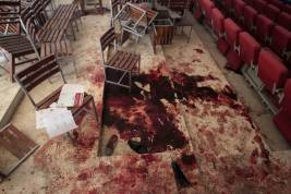 Shoes lie in blood on the auditorium floor at the Army Public School, which was attacked by Taliban gunmen, in Peshawar